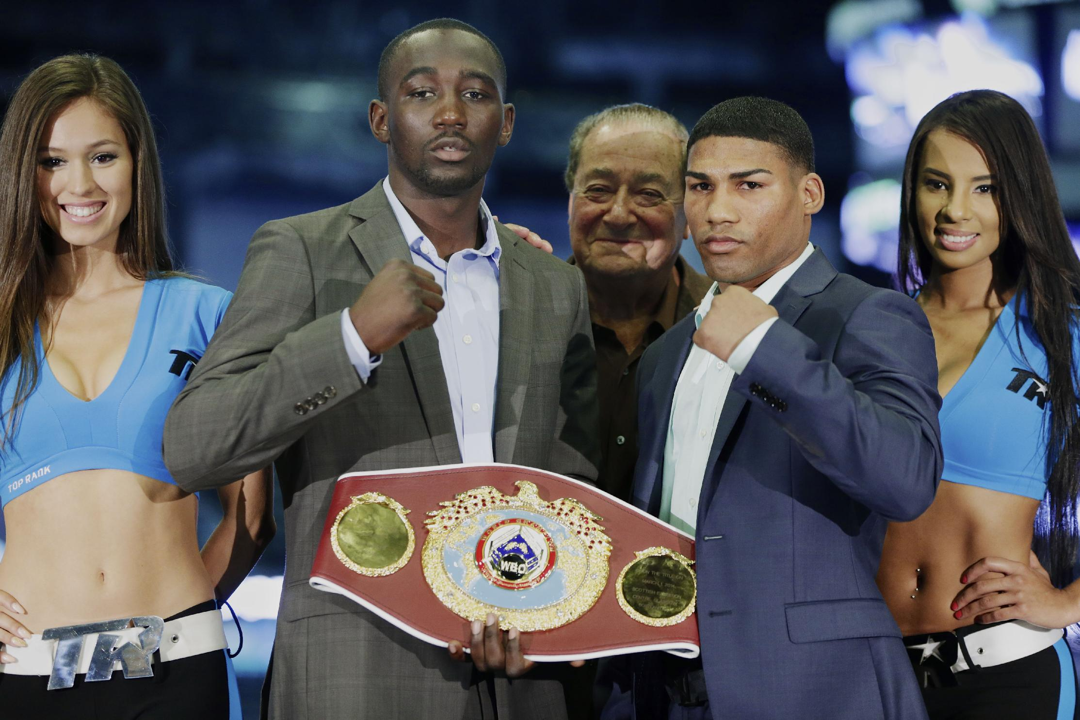 Boxers Terence Crawford, second from left, and Yuriorkis Gamboa, second from right, pose for a photo with promoter Bob Arum, center, during a news conference in Omaha, Neb., Thursday, May 8, 2014, to announce their world lightweight championship fight in June. Crawford will defend his WBO title in his hometown, in the first world championship fight in Omaha since Joe Frazier stopped Ron Stander in 1972
