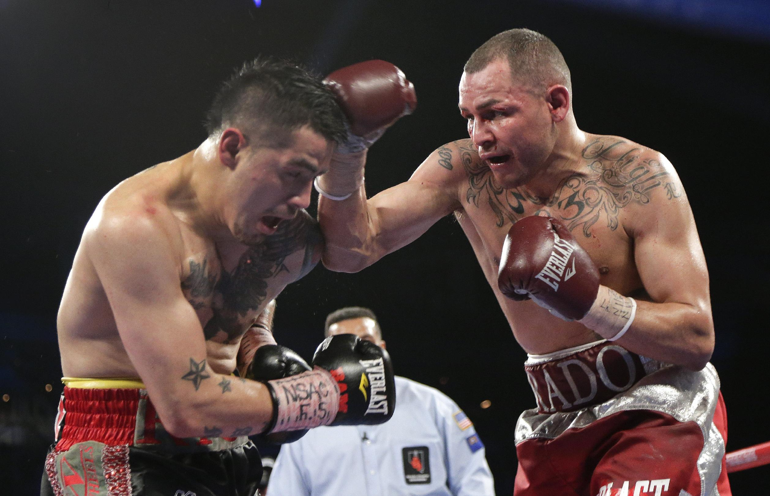 In this March 30, 2013 file photo, Mike Alvarado, right, exchanges punches with Brandon Rios during a WBO super lightweight title fight in Las Vegas. Alvadado is scheduled to fight Juan Manuel Marquez at the Forum in Inglewood, Calif., on Saturday, May 17