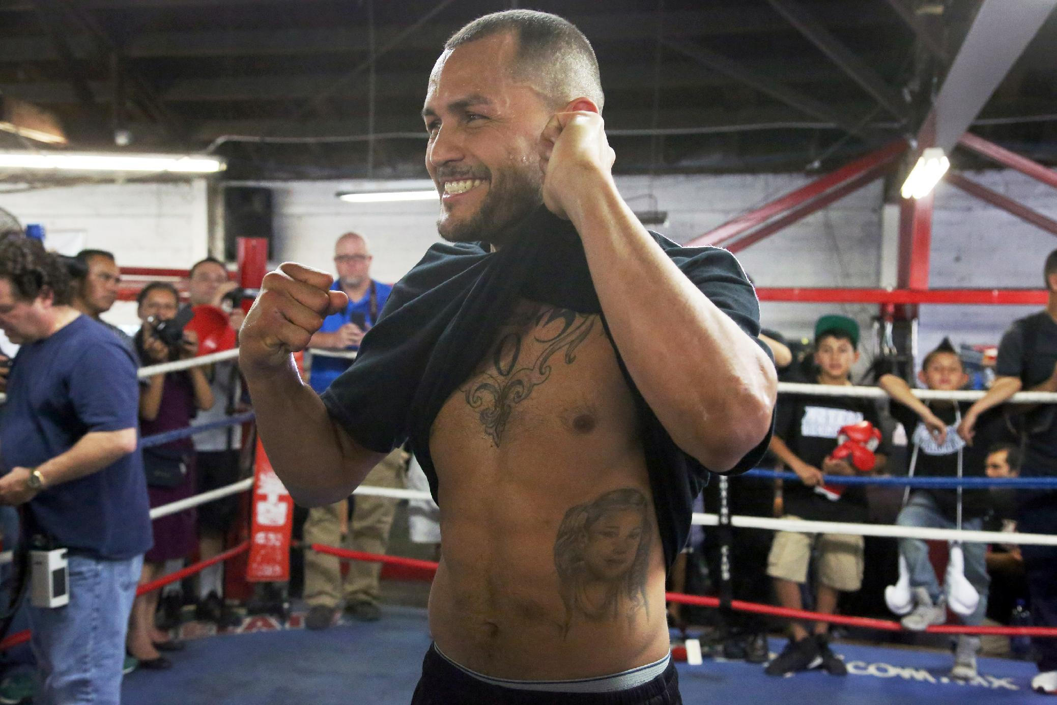 Mike Alvarado poses in the ring during a workout in front of the media in Bell, Calif., Wednesday, May 14, 2014. He and Juan Manuel Marquez, of Mexico, are preparing for their WBO welterweight elimination bout at the Forum in Inglewood, Calif., Saturday. The winner will become the mandatory challenger to WBO welterweight champion Manny Pacquiao