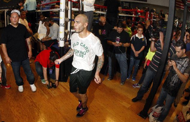 In this photograph taken with a fisheye lens, boxer Miguel Cotto works out at Everlast Lab ahead of his match against Sergio Martinez, Tuesday, June 3, 2014, in Hoboken, N.J. The two will fight for Martinez's WBC middleweight title, on June 7 at Madison Square Garden in New York