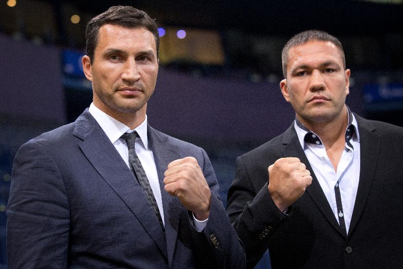 IBF , WBO- and  WBA heavyweight boxing champion, Ukraine's Wladimir Klitschko, left,   and his challenger Bulgaria's  Kubrat Pulev , right, pose after a press conference in Hamburg, northern Germany, Wednesday June 25, 2014.  Klitschko will face Pulev in a  title bout on Sept. 6, 2014 in Hamburg
