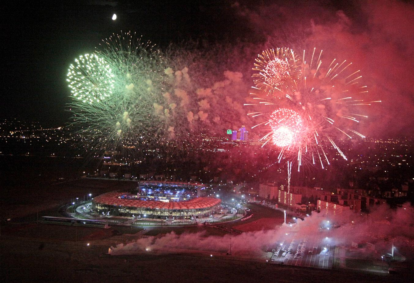 Fireworks explode over the Ahmat Arena, after the WBA heavyweight boxing championship fight between Uzbekistan's Ruslan Chagaev and Fres Oquendo of the United States, in Grozny, Russia, Monday, July 7, 2014. Former WBA heavyweight champion Chagaev became a two-time champ, as he won a 12-round majority verdict over Fres Oquendo to pick up the