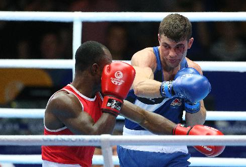 England's Scott Fitzgerald, right, bleeds after a clash of heads with Ghana's Azumah Mohammed in the men's welterweight preliminaries bout at the Commonwealth Games Glasgow 2014, Scotland, Monday July 28, 2014