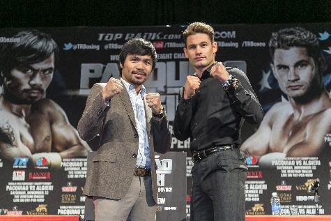 Boxers Manny Pacquiao, left, and Chris Algieri pose for a photo in Los Angeles, Wednesday, Sept. 3, 2014. They will fight for Pacquiao's WBO welterweight title at The Venetian, Macao, on Nov. 22