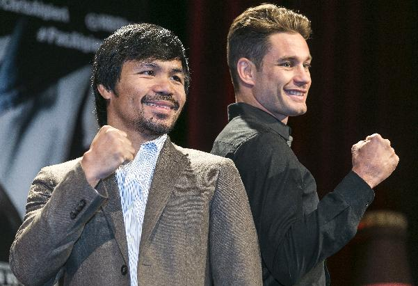 Boxers Manny Pacquiao, left, and Chris Algieri pose for a photo in Los Angeles, Wednesday, Sept. 3, 2014. They will fight for Pacquiao's WBO welterweight title at The Venetian Macao hotel on Nov. 22