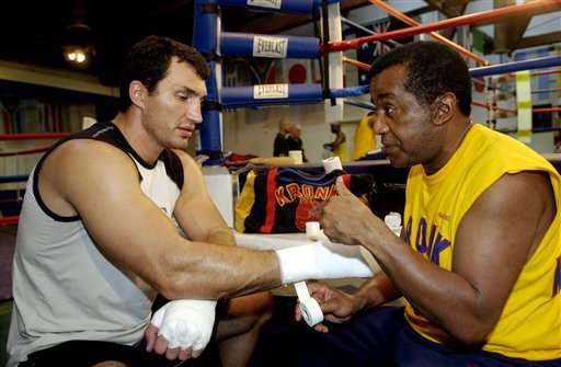 Wladimir Klitschko gets his hands taped by trainer Emanuel Steward on Sept. 9, 2004. (AP)