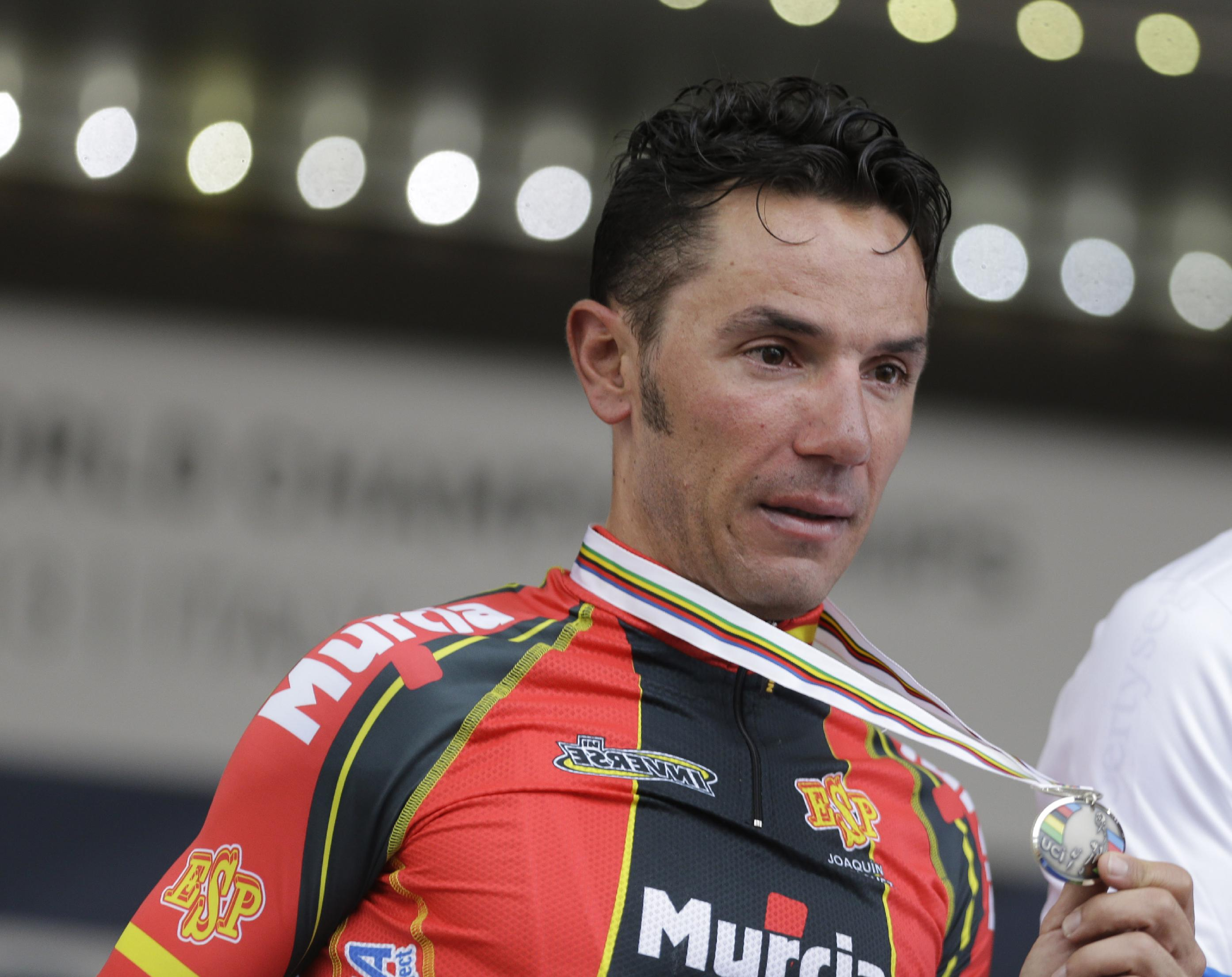Silver medalist Joaquin Rodriguez, of Spain, shows his medal during the podium ceremony for the men's elite road race event, at the road cycling world championships, in Florence, Italy, Sunday, Sept. 29, 2013