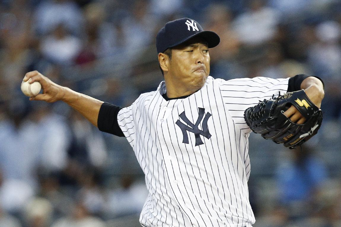 In this Sept. 3, 2013, file photo, New York Yankees starting pitcher Hiroki Kuroda, of Japan, throws during a baseball game against the Chicago White Sox in New York. Yankees managing general partner Hal Steinbrenner said Friday, Dec. 6, Kuroda is returning for a third season