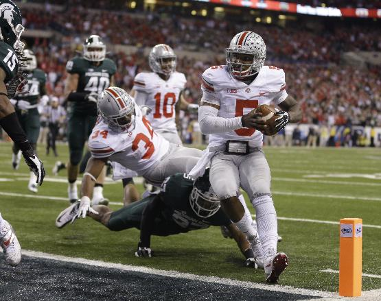 In this Dec. 7, 2013 file photo, Ohio State's Braxton Miller (5) goes in on a 8-yard touchdown run during the second half of a Big Ten Conference championship NCAA college football game against Michigan State in Indianapolis. Even though it has sunshine, warm weather and spectacular food and nightlife, the Orange Bowl wasn't exactly where Ohio State wanted to play, it's a pretty good consolation prize after they suffered their first loss in two seasons in the Big Ten title game