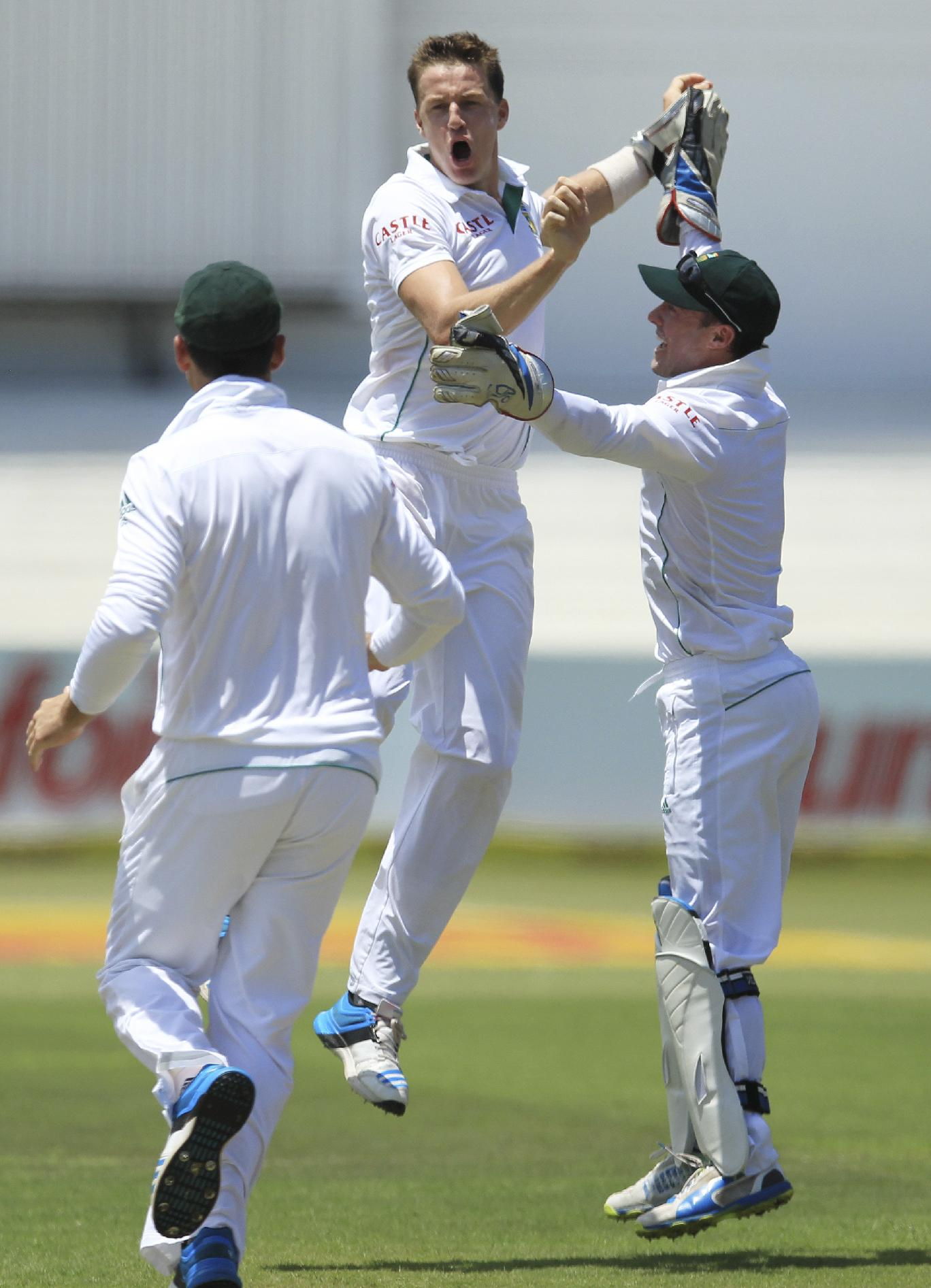 South Africa's bowler Morne Morkel, center, celebrates with teammates after dismissing India's batsman Shikhar Dhawan for 29 runs during first day of their cricket test match at Kingsmead stadium, Durban, South Africa, Thursday, Dec. 26, 2013