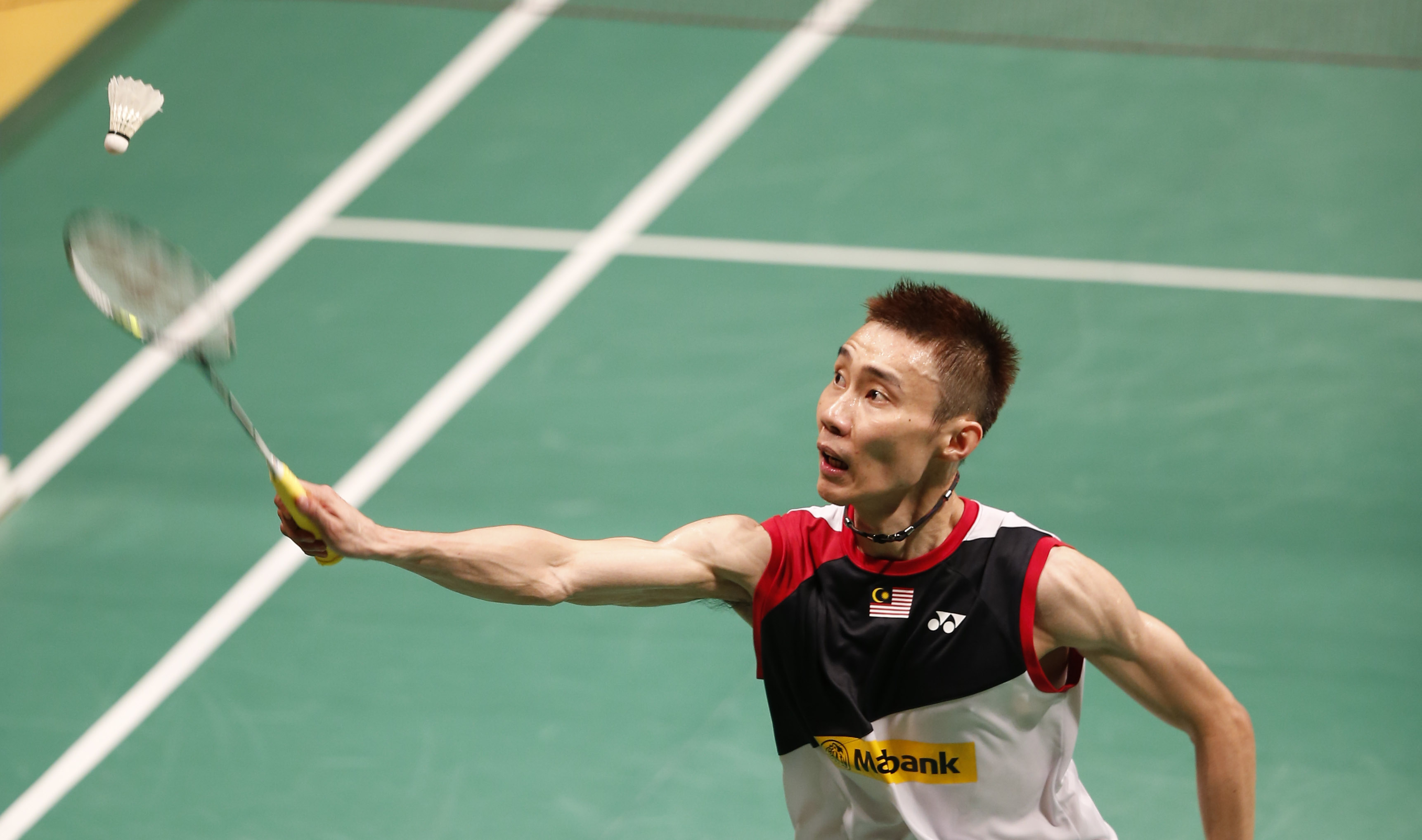 Malaysia's Lee Chong Wei returns the shuttlecock to China's Wang Zhengming during their men's singles match at the Malaysia Open Badminton Super Series in Kuala Lumpur, Malaysia, Thursday, Jan. 16, 2014