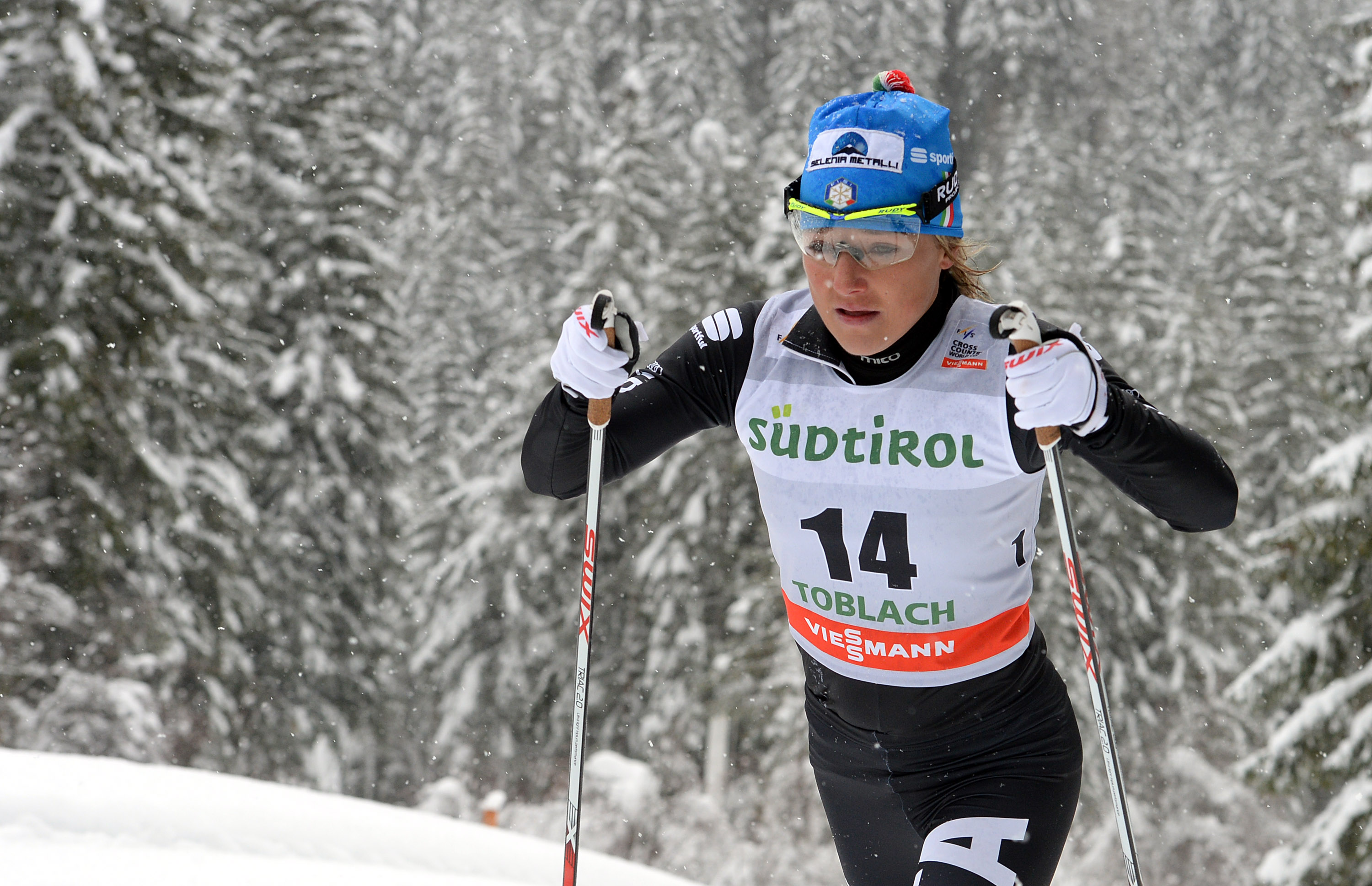 Marina Piller of Italy competes during a cross country ski, women's World Cup, 10-kilometer classic race, in Dobbiaco, Italy, Saturday, Feb.1, 2014