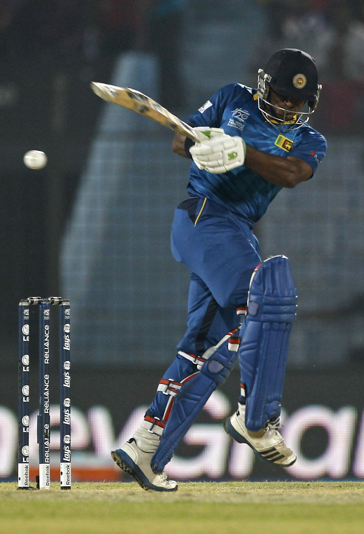 Sri Lanka's Kusal Perera plays a shot during their ICC Twenty20 Cricket World Cup match against England in Chittagong, Bangladesh, Thursday, March 27, 2014
