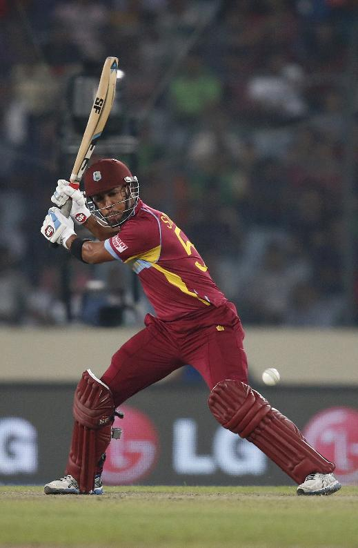West Indies' batsman Lendl Simmons prepares to play a shot during their ICC Twenty20 Cricket World Cup match against Pakistan in Dhaka, Bangladesh, Tuesday, April 1, 2014