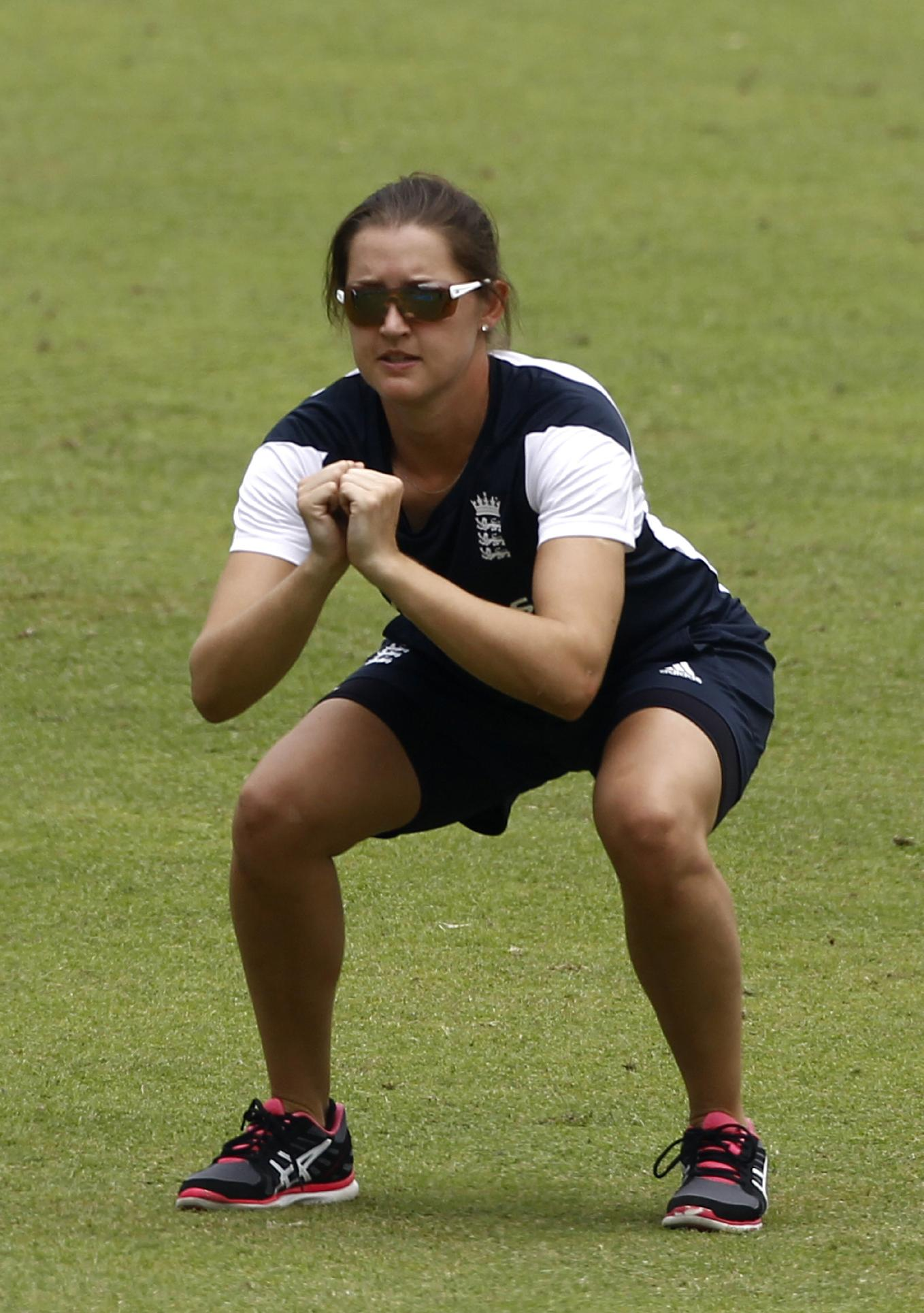 England women's team cricket player Sarah Taylor stretches during a training session ahead of their ICC Twenty20 Cricket World Cup final match against Australia in Dhaka, Bangladesh, Saturday, April 5, 2014