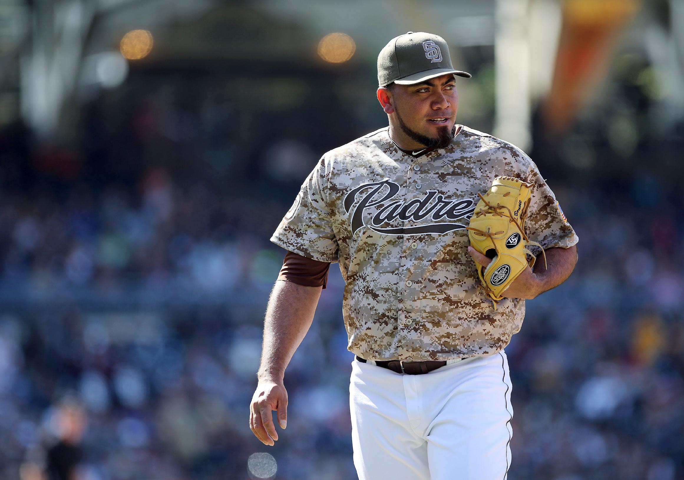 San Diego Padres relief pitcher Jouquin Benoit walks off the field after pitching the eighth inning against the Detroit Tigers in a baseball game on Sunday, April 13, 2014, in San Diego. San Diego Padres won the game 5-1