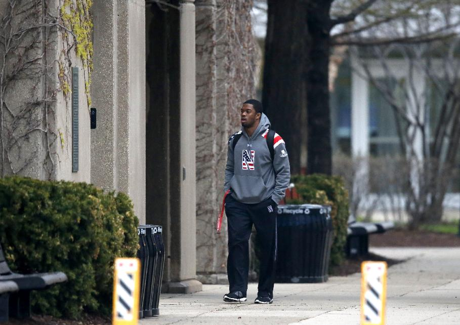 Northwestern football player Dwight White walks into McGaw Hall, where voting is taking place on the student athlete union question Friday, April 25, 2014, in Evanston, Ill. Northwestern football players cast secret ballots Friday in an on-campus hall adjacent to their home stadium on whether to form the nation's first union for college athletes