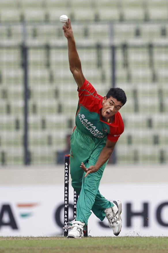 Bangladesh's Taskin Ahmed bowls during the second one-day International cricket match against India in Dhaka, Bangladesh, Tuesday, June 17, 2014
