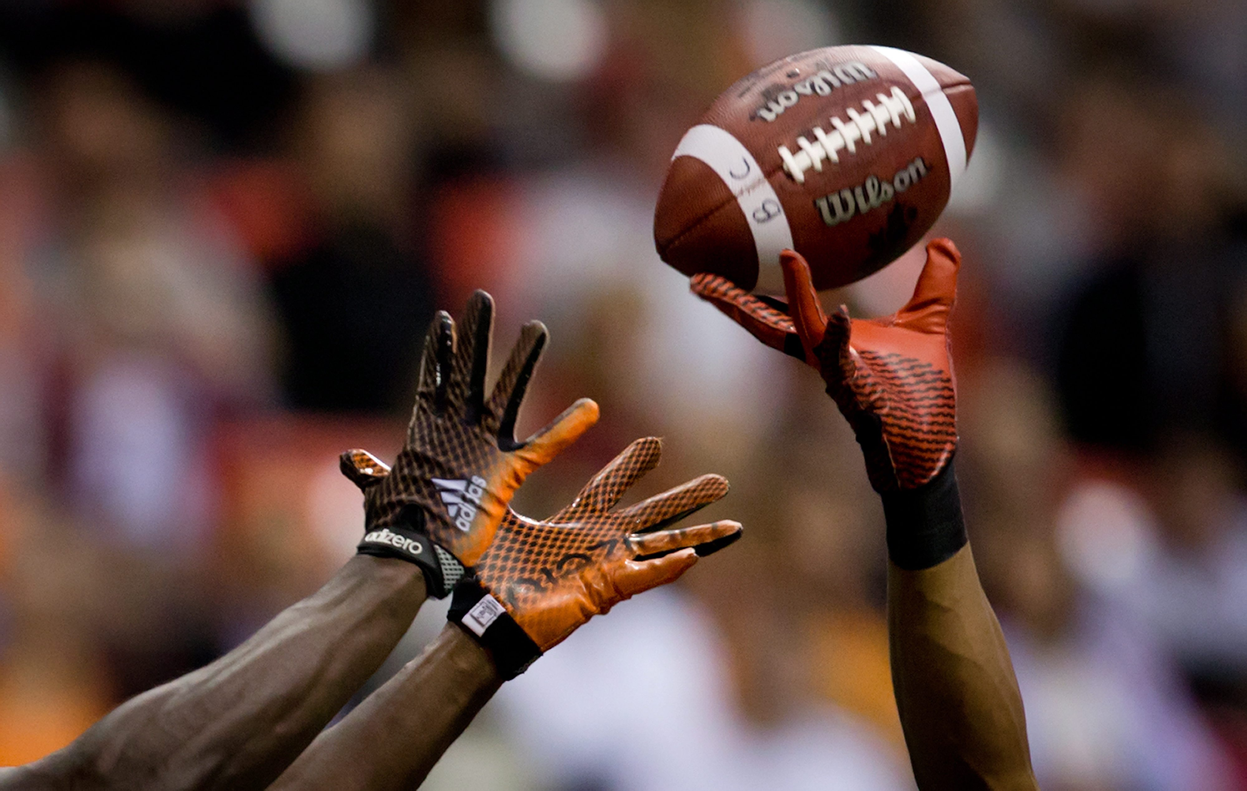 Calgary Stampeders' Ryan Steed, right, breaks up a pass intended for B.C. Lions' Stephen Adekolu in the end zone during the second half of a preseason Canadian Football League game in Vancouver, British Columbia, on Friday, June 20, 2014