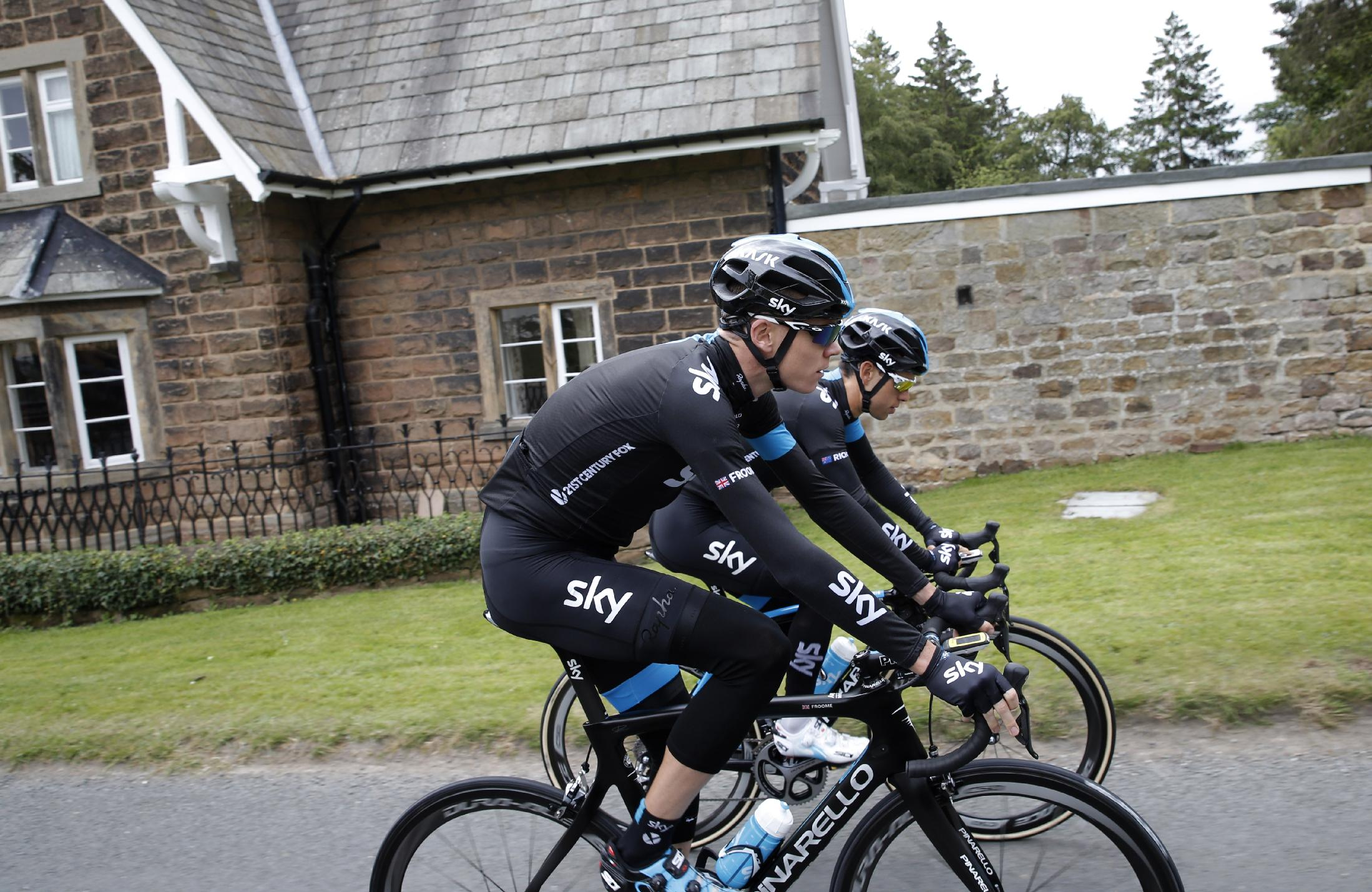 Britain's Christopher Froome, foreground, and his main mountain helper Richie Porte of Australia, rear, ride during a training ahead of the Tour de France cycling race in Leeds, Britain, Thursday, July 3, 2014. The Tour de France will start on Saturday July 5th in Leeds, and finishes in Paris on Sunday July 27th