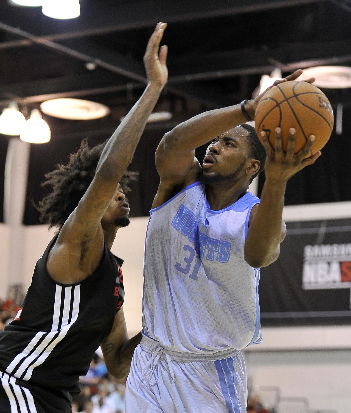 Denver Nuggets' Denzel Bowles (31) shoots against Toronto Raptors' Lucas Nogueira during an NBA summer league basketball game on Saturday, July 12, 2014, in Las Vegas. The Nuggets won 110-82
