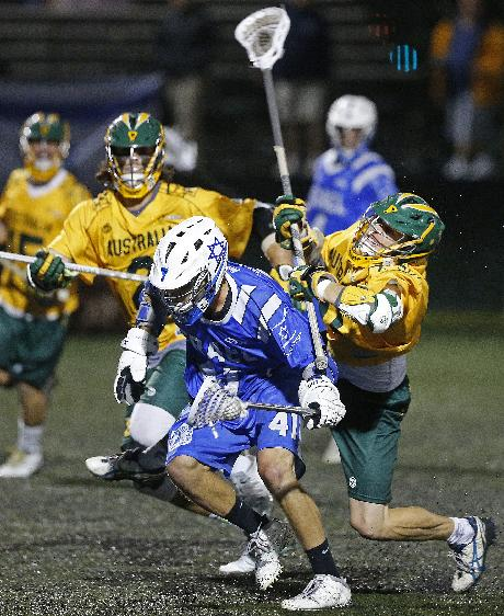 Australia defenseman Keith Nyberg, right, bodychecks Israel's Noah Miller as Miller advances the ball downfield in a semi-final game against in the Lacrosse World Championships, in Commerce City, Colo., Wednesday, July 16, 2014. Australia won 9-8