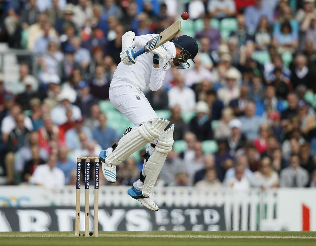 England's Stuart Broad avoids a short ball from India's Ishant Sharma during the third day of the fifth test cricket match at Oval cricket ground in London, Sunday, Aug. 17, 2014