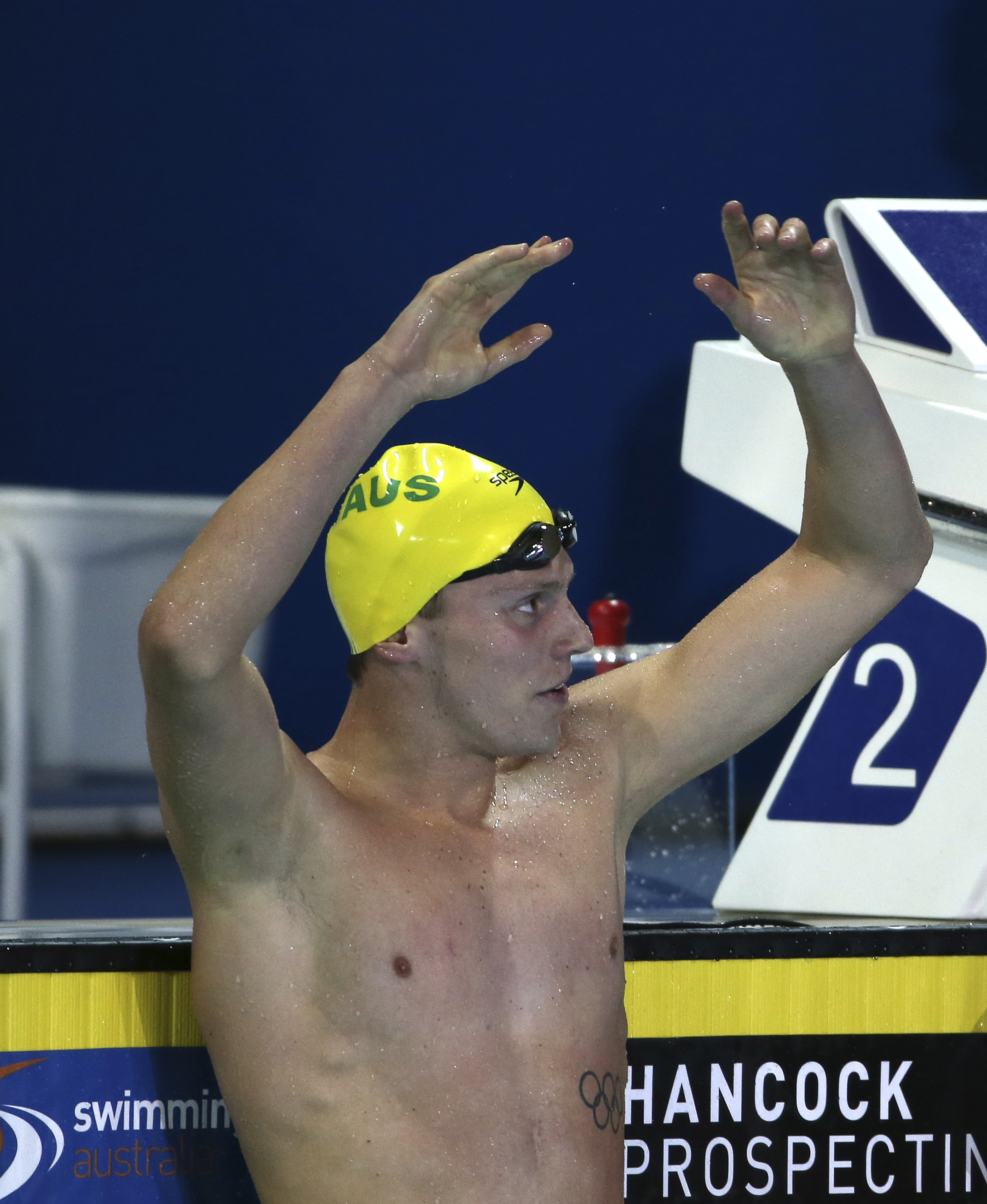 Thomas Fraser-Holmes holds his arms up in the air after winning his men's 200m freestyle final at the Pan Pacific swimming championships in Gold Coast, Australia, Thursday, Aug. 21, 2014
