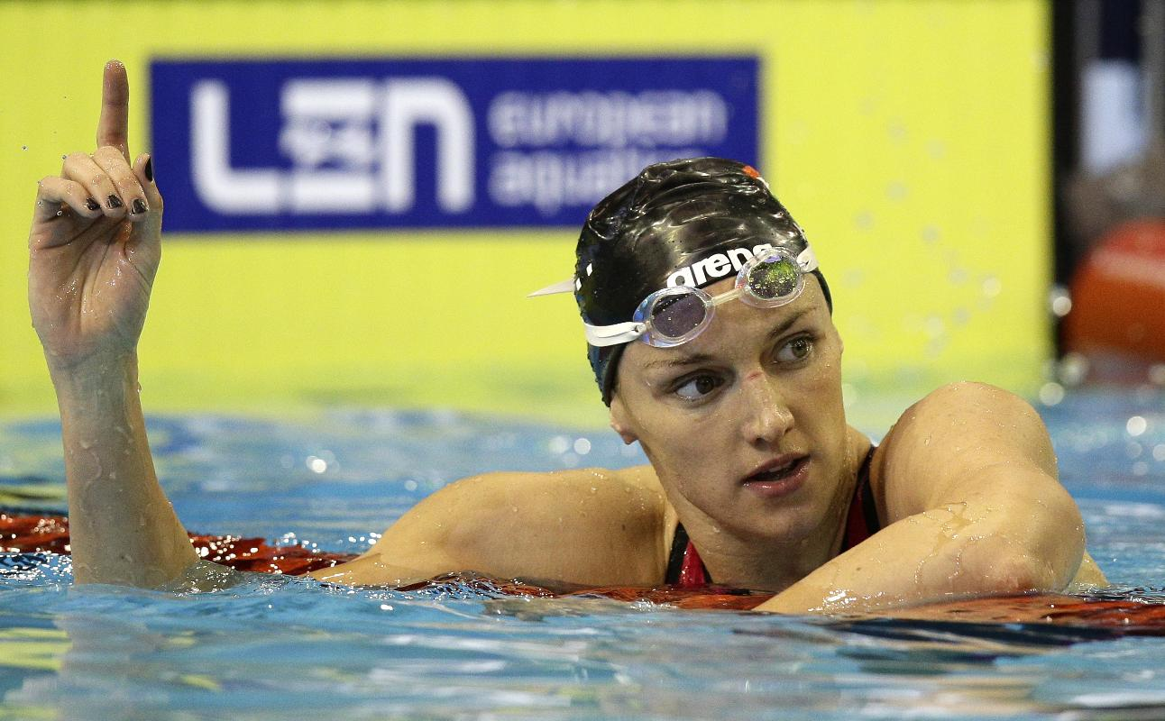 Hungary's Katinka Hosszu celebrates winning the gold medal in the women's 100m backstroke final at the LEN Swimming European Championships in Berlin, Germany, Thursday, Aug. 21, 2014