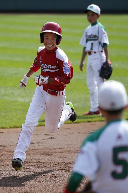 Japan's Hayato Ueshima, left, rounds second after hitting a solo home run off Mexico's Erick Vela in the first inning of an International elimination baseball game at the Little League World Series tournament in South Williamsport, Pa.,  Thursday, Aug. 21, 2014