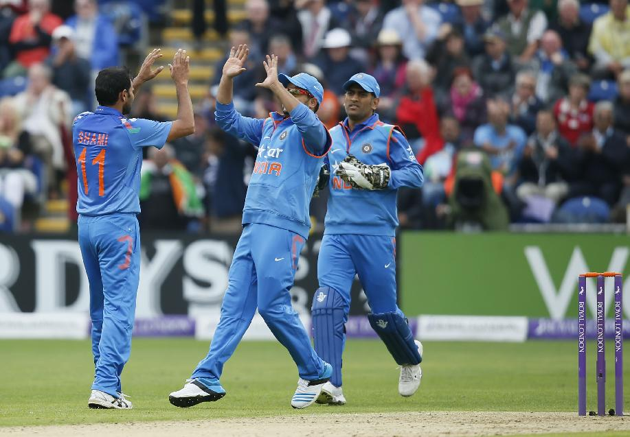 India's Mohammed Shami, left, celebrates taking the wicket of England's Alastair Cook, lbw, during their One Day International cricket match at the SWALEC cricket ground in Cardiff, Wales, Wednesday, Aug. 27, 2014