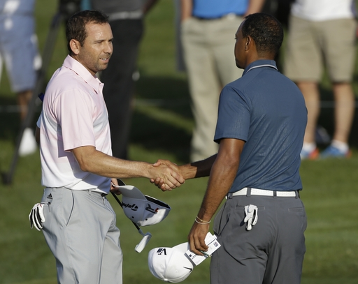 Tiger Woods and Sergio Garcia shake hands at TPC Sawgrass. (AP)