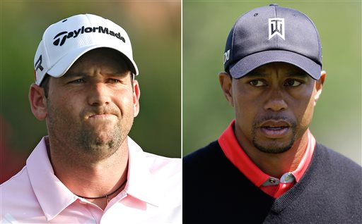 At left, in a May 5, 2013 file photo, Sergio Garcia grimaces during The Players Championshop golf tournament in Ponte Vedra Beach, Fla. At right, in a March 25, 2013 file photo, Tiger Woods walks to the 16th green during the final round of the Arnold Palmer Invitational golf tournament in Orlando, Fla. Woods and Garcia don't like each other, and are making no attempt to disguise their feelings