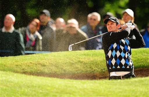 England's Justin Rose during the first day of the BMW PGA Championship at the Wentworth Club, Virginia Water, England, Thursday, May 23, 2013. (AP Photo / Adam Davy, PA )