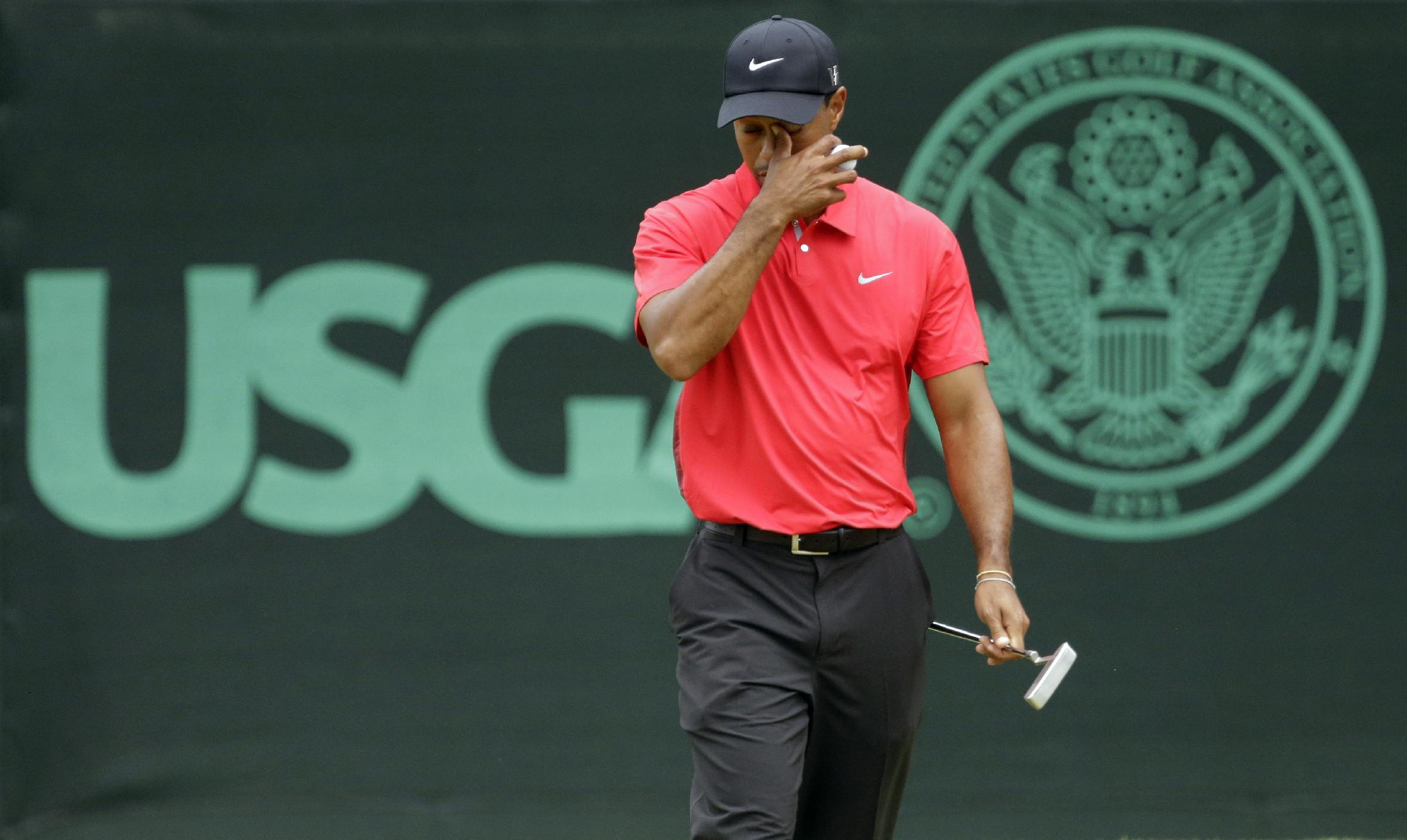 Tiger Woods reacts after putting on the eighth green at the U.S. Open. (AP)