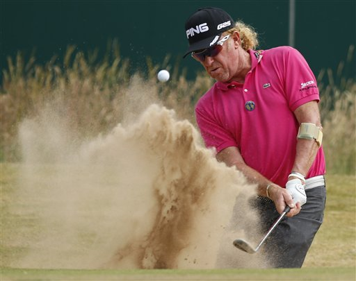Miguel Angel Jimenez plays out of a sand trap on the 18th hole. (AP)