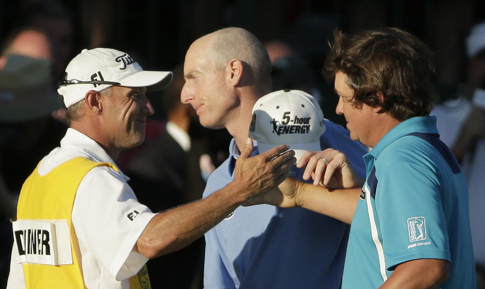 Jason Dufner, right, celebrates winning the PGA Championship as Jim Furyk, center, walks away. (AP)