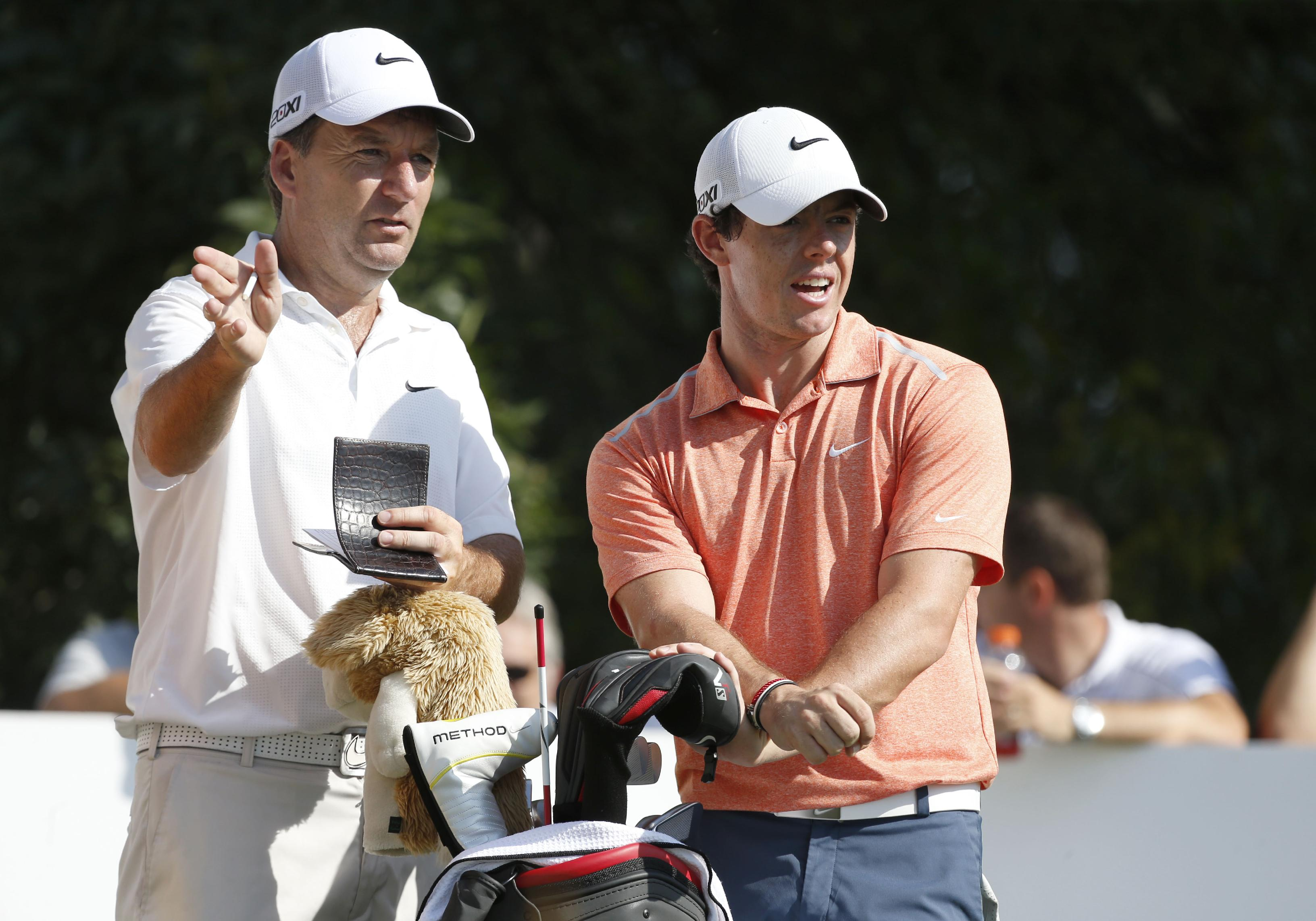 Golfer Rory McIlroy, right, of Northern Ireland, listens to caddie JP Fitzgerald at the 10th tee during the pro-am round of the 2013 BMW Championship golf tournament at Conway Farms Golf Club in Lake Forest. Ill., Wednesday, Sept. 11, 2013