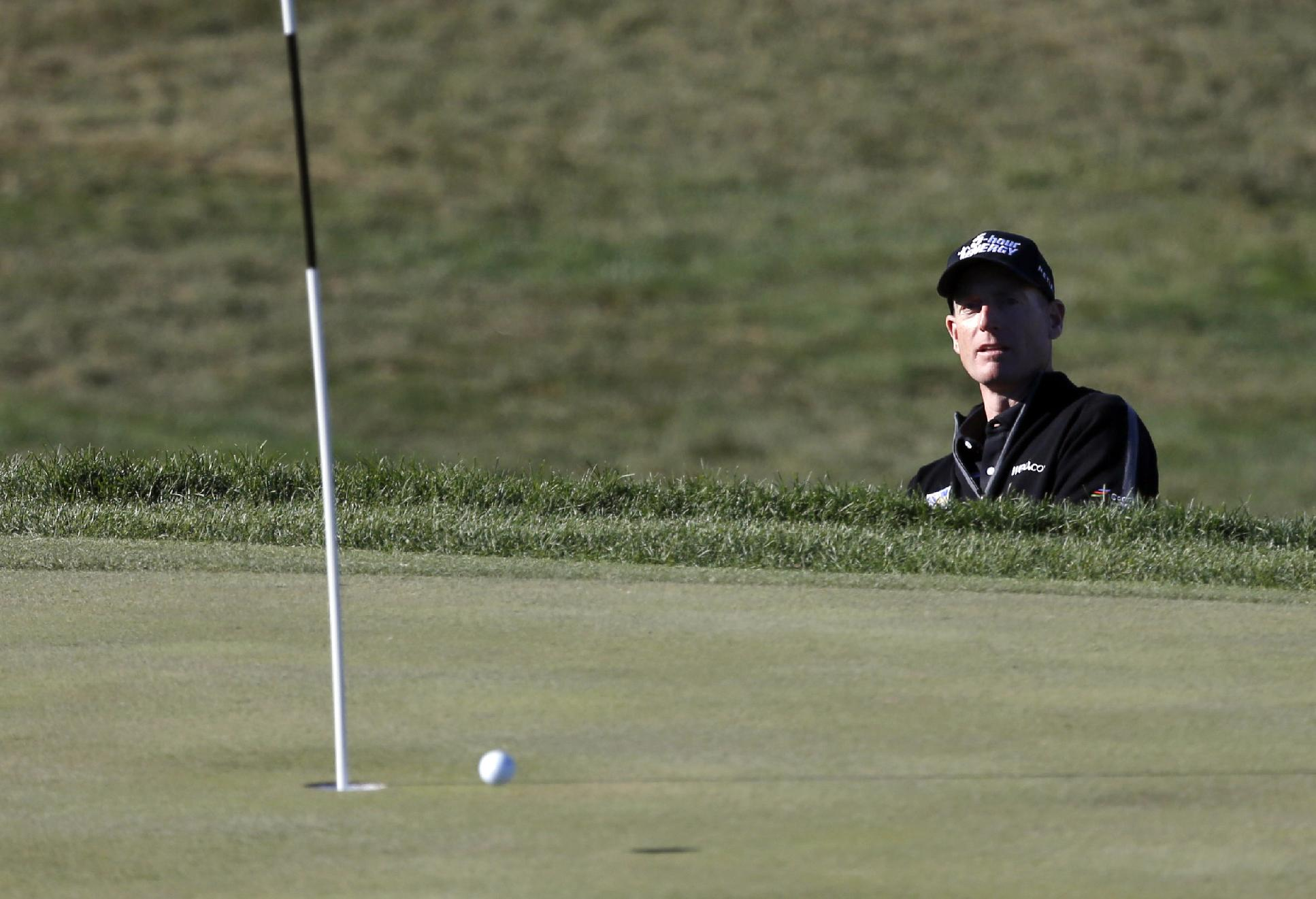 Jim Furyk watches his chip shot to the eighth green during the second round of the BMW Championship golf tournament at Conway Farms Golf Club in Lake Forest, Ill., Friday, Sept. 13, 2013. Furyk posted a single round 59, tying the PGA Tour record