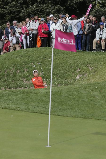 Mika Miyazato, of Japan, plays out of a bunker on the 5th hole during the third and last round of the Evian Championship women's golf tournament in Evian, eastern France, Sunday, Sept. 15, 2013