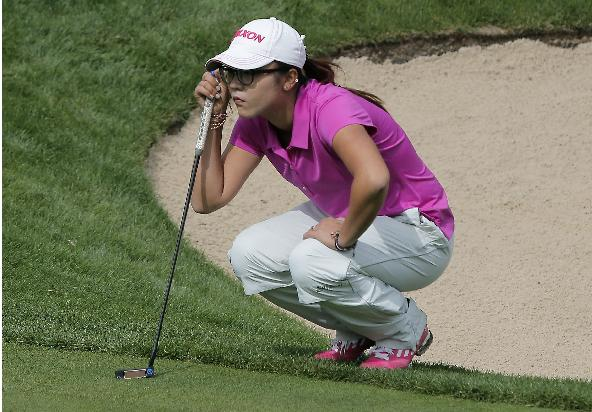 Lydia Ko, of New Zealand, studies her putt before playing on the 5th green during the third and last round of the Evian Championship women's golf tournament in Evian, eastern France, Sunday, Sept. 15, 2013