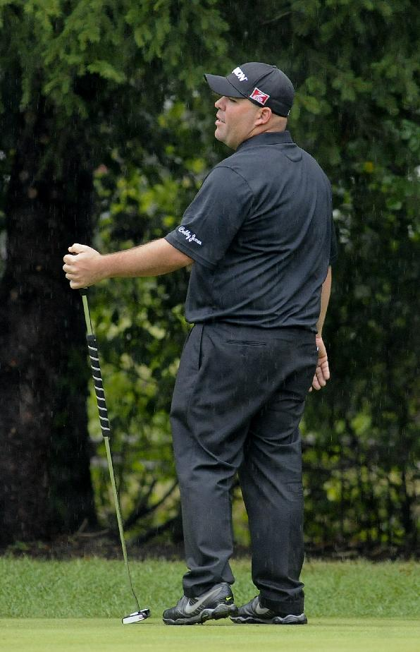 Kevin Stadler reacts to his putt onto the first green during the final round of the BMW Championship golf tournament at Conway Farms Golf Club in Lake Forest, Ill., Sunday Sept. 15, 2013