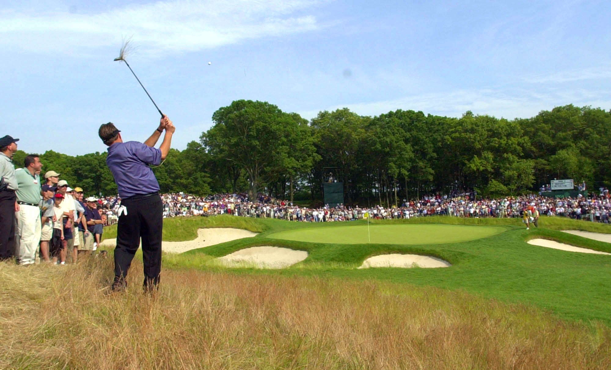 In this June 16, 2002, file photo, Phil Mickelson hits to the fifth green from the rough during the final round of the U.S. Open Golf Championship at the Black Course of Bethpage State Park in Farmingdale, N.Y. The PGA of America announced Tuesday, Sept. 17, 2013, that course will host the 2019 PGA Championship and 2024 Ryder Cup