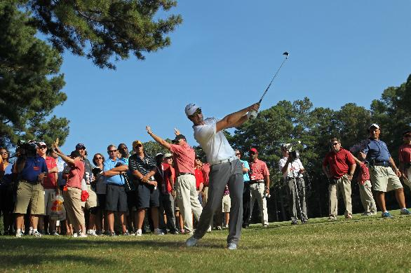 Henrik Stenson follows through on his second shot on the 16th rough during round one of the 2013 Tour Championship golf tournament at East Lake Golf Club, Thursday, Sept. 19 2013, in Atlanta. Stenson finished first with a round of 6 under par