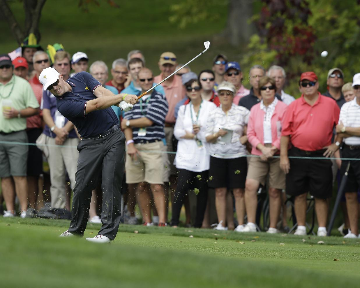 United States team player Hunter Mahan hits from the first fairway during a four-ball match against the International team at the Presidents Cup golf tournament at Muirfield Village Golf Club Thursday, Oct. 3, 2013, in Dublin, Ohio
