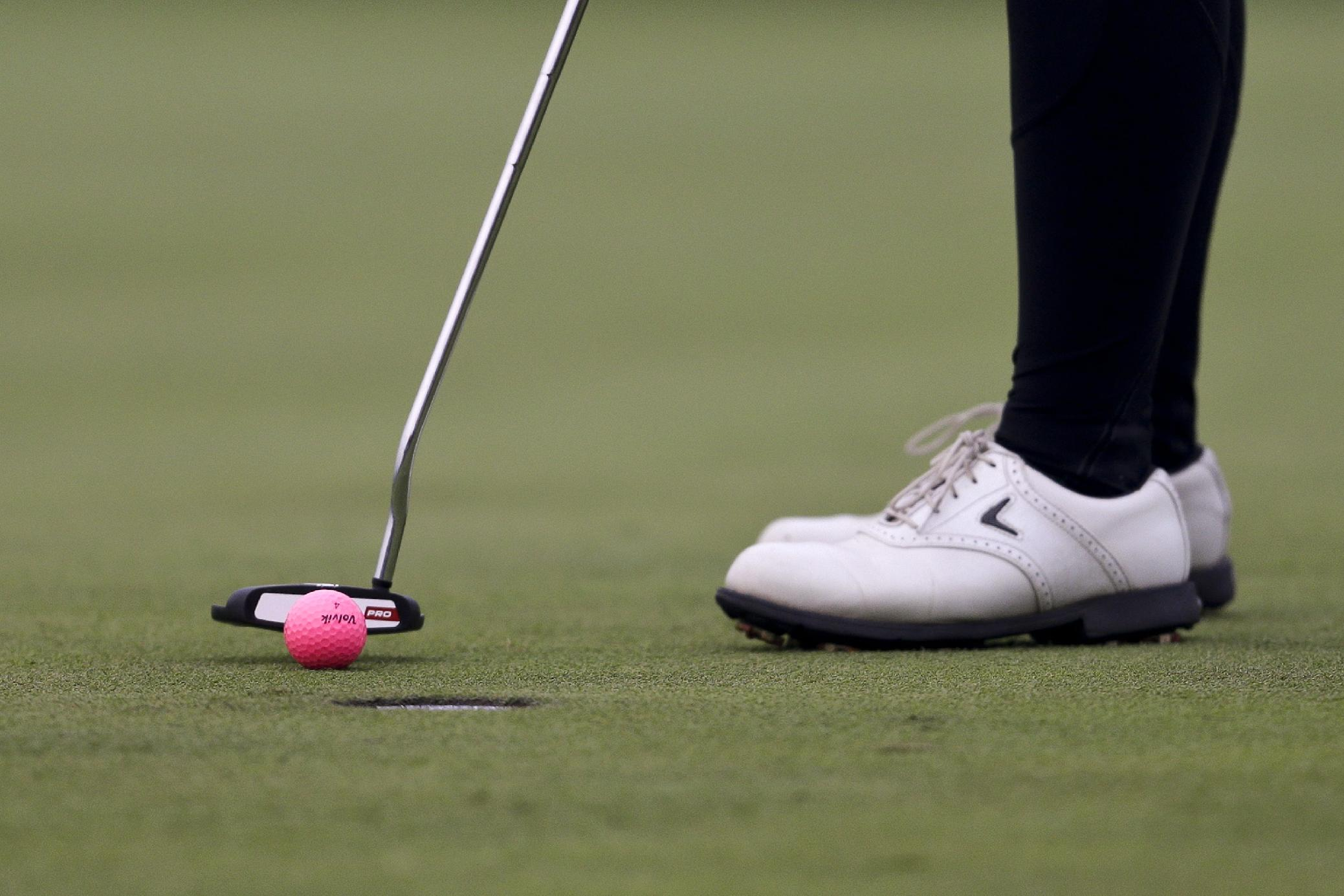 Thailand's Pornanong Phatlum putts on the 18th hole during the third round of the Reignwood LPGA Classic golf tournament at Pine Valley Golf Club on the outskirts of Beijing, China, Saturday, Oct. 5, 2013