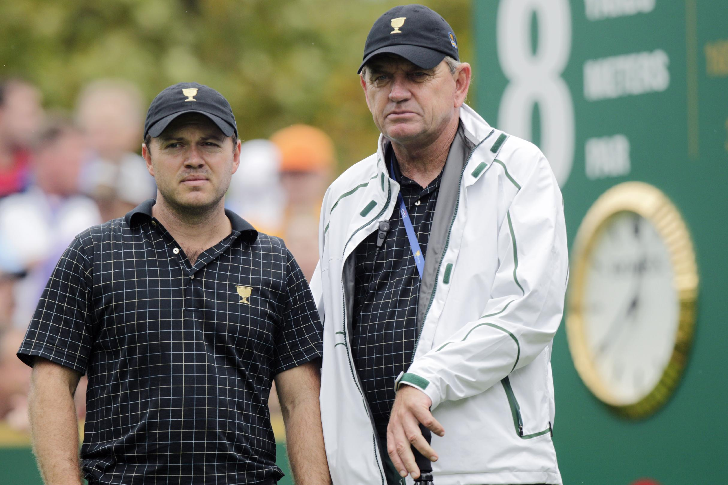 International team player Richard Sterne, left, of South Africa, and International team captain Nick Price talk on the eighth tee box during the single matches at the Presidents Cup golf tournament at Muirfield Village Golf Club Sunday, Oct. 6, 2013, in Dublin, Ohio