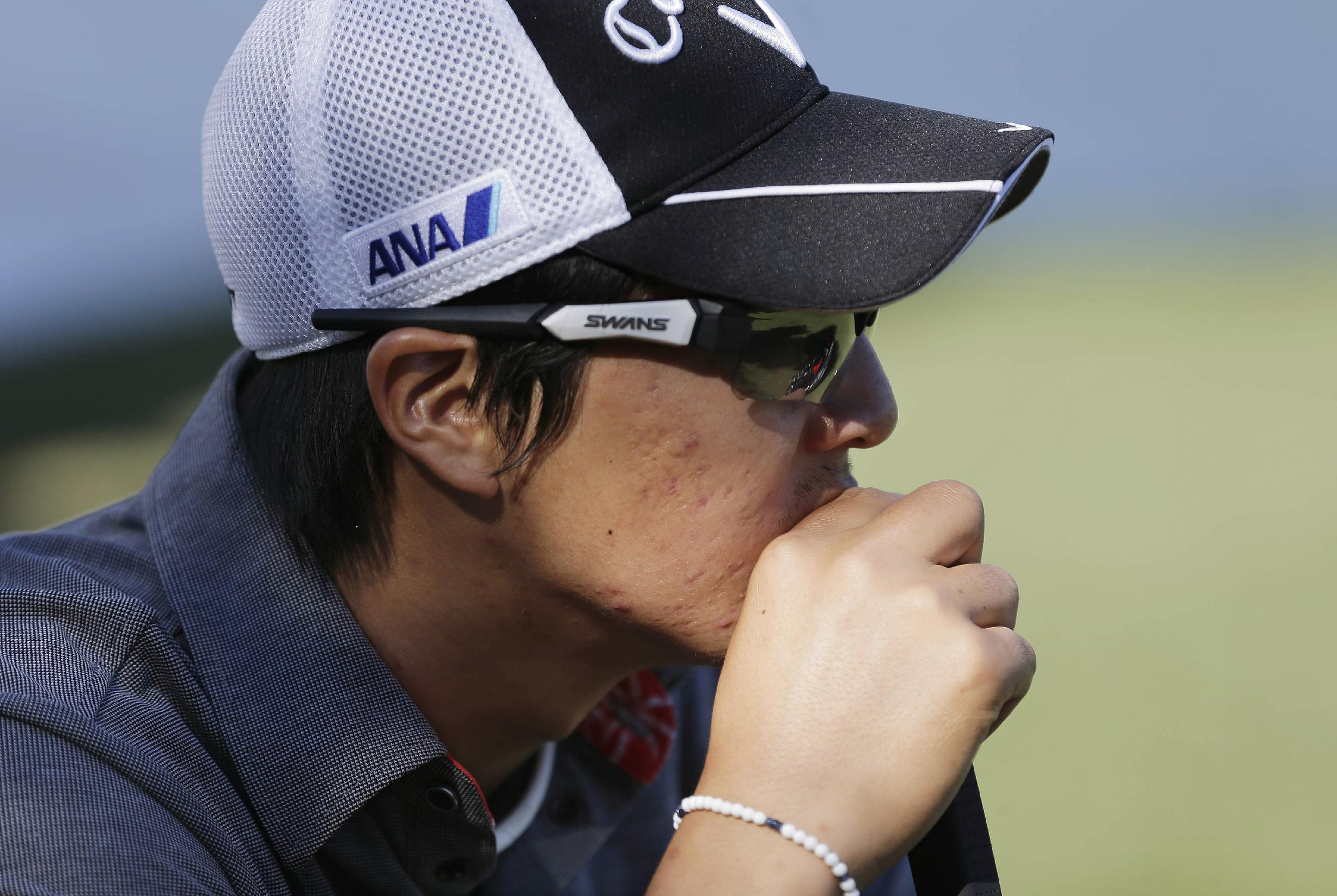 Japan's Ryo Ishikawa waits to putt on the 15th green in the first round of the Shriners Hospitals for Children Open golf tournament, Thursday, Oct. 17, 2013, in Las Vegas