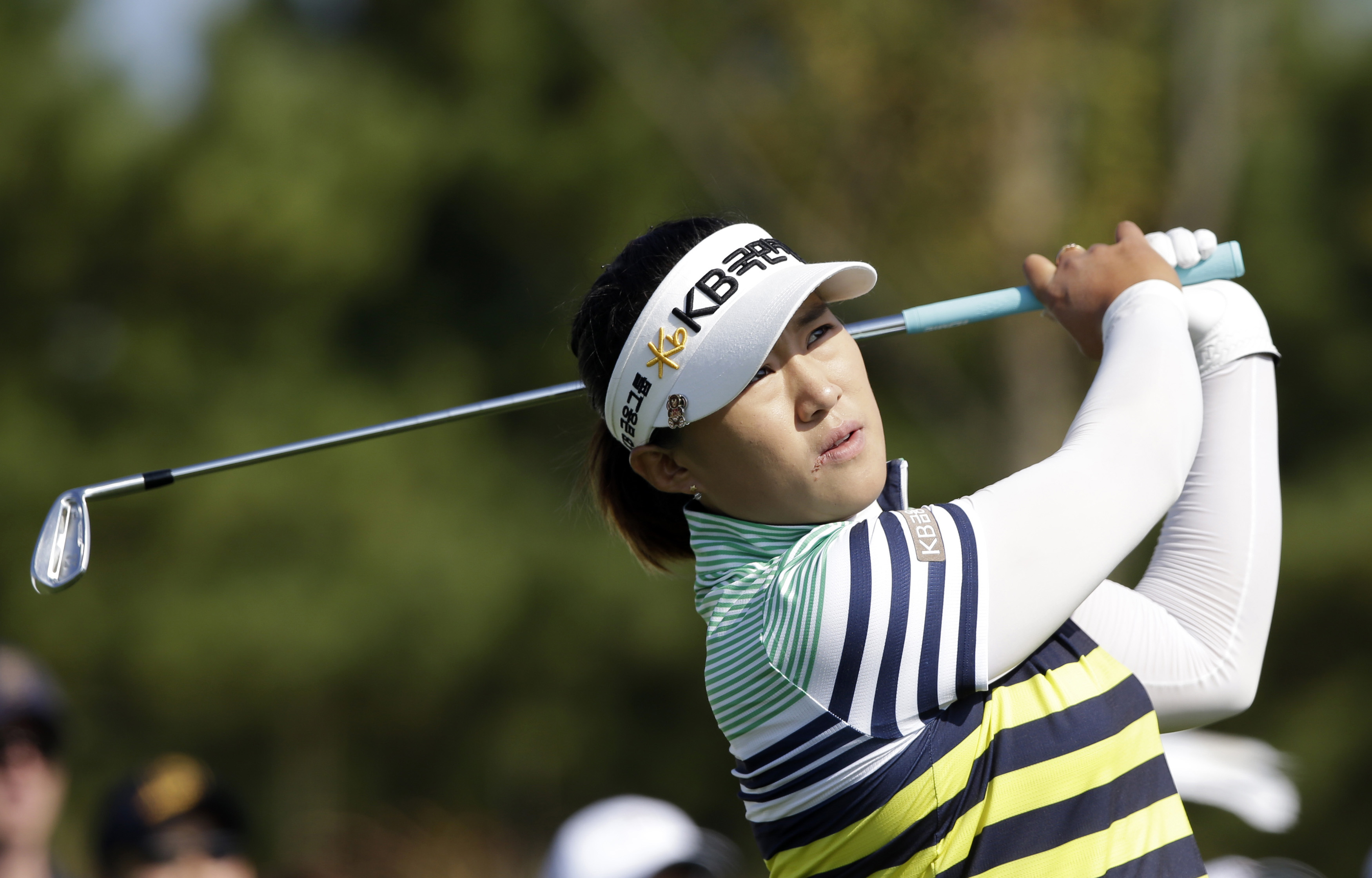 Amy Yang of South Korea watches her shot during the final round of the KEB Hana Bank Championship golf tournament at Sky72 Golf Club in Incheon, west of Seoul, South Korea, Sunday, Oct. 20, 2013