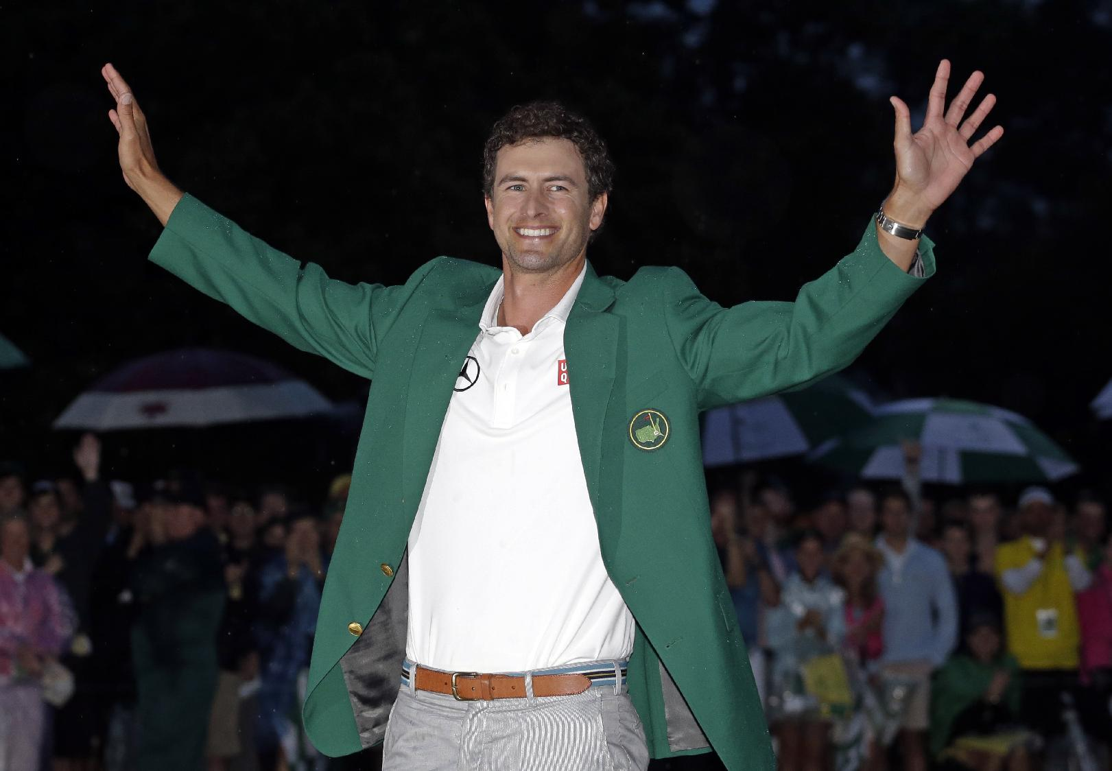 In this April 14, 2013 file photo, Adam Scott, of Australia, celebrates with his green jacket after winning the Masters golf tournament in Augusta, Ga. Scott considers his 20-foot birdie putt on the 18th green the signature moment of his career, even if it wasn't the putt that made him the first Australian to win the Masters